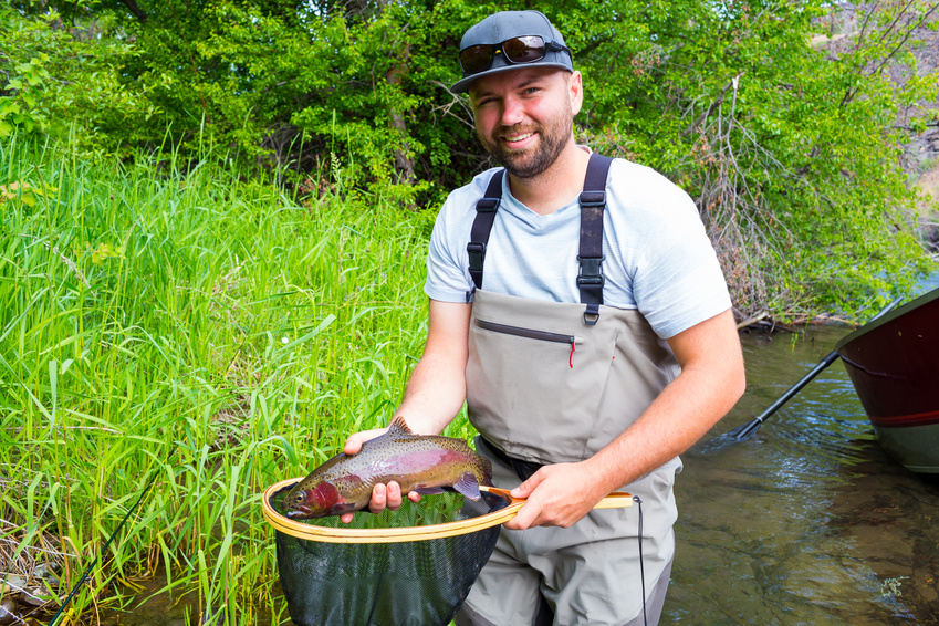 Fly Fisherman Holding Trophy Rainbow Trout